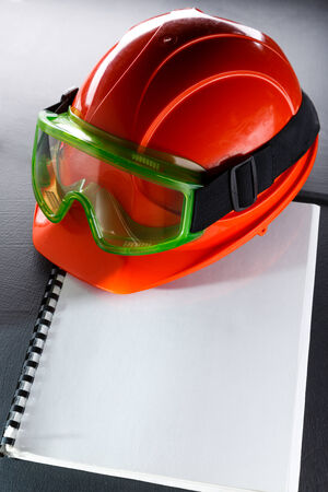 Green goggles and red helmet