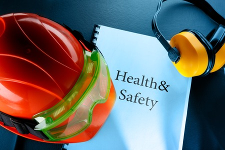 Safety goggles, earphones and red helmet Stock Photo - 31094353