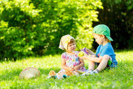 Little boy and girl playing on the grass photo