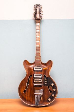 instruments: Old electric guitar vertical