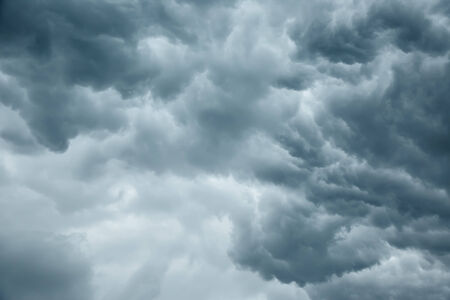 cloudy moody: Stormy grey cloudy sky background Stock Photo