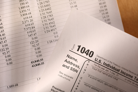 financial gains: Tax form and operating budget Stock Photo