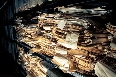 Paper documents stacked in archive photo