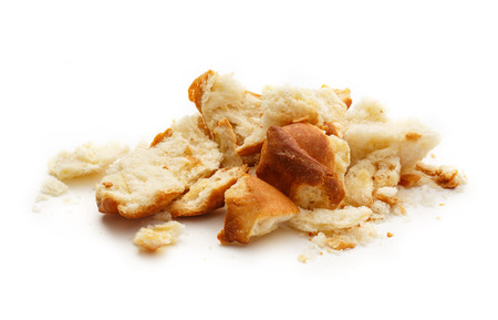 crumbing: Dried bread crumbs on the white background Stock Photo