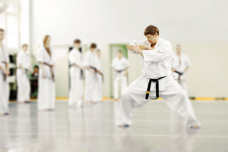 Lesson in karate school for adults and children