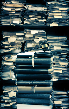 proceeding: Paper documents stacked in archive in closeup
