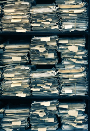 office paper: Paper documents stacked in archive on shelf
