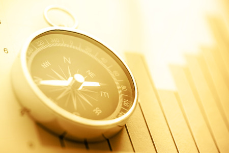 Diagram concept with compass and arrow in sepia toning Stock Photo