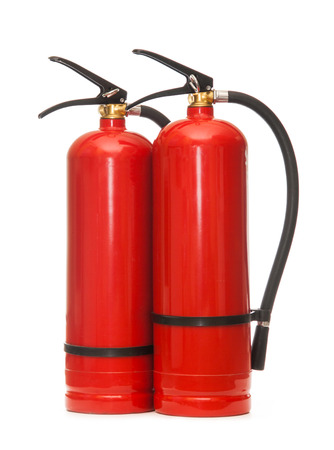 extinguishers: New blank red fire extinguishers in closeup Stock Photo