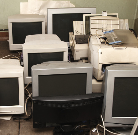 Old computer monitors gathered on the floor