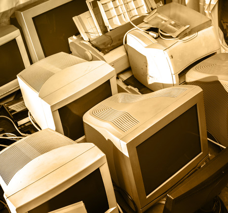 Old computer monitors gathered on the floor photo
