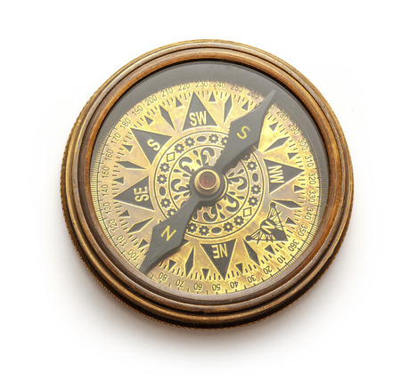 magnetic north: Close up view of vintage compass on white