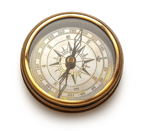 Close up view of vintage compass on white photo