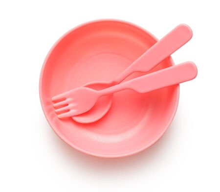 Pink plastic tableware dish, spoon and fork photo