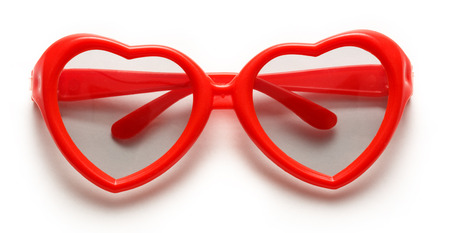 Red heart shaped sunglasses on white background Foto de archivo