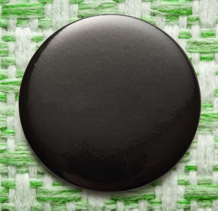 plain button: Blank single black round badge in closeup