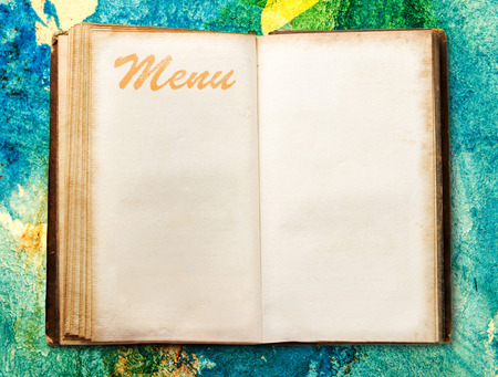 Open blank vintage menu book on background photo