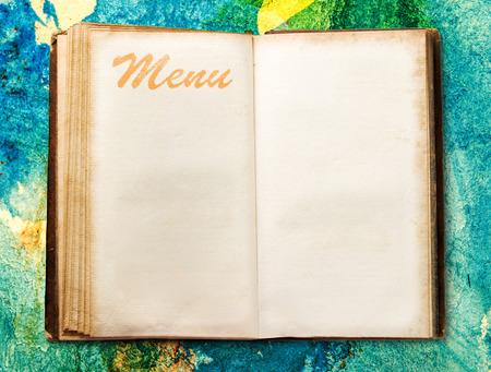 Open blank vintage menu book on background photo