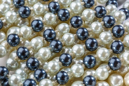 string of pearls: String of black and white pearls closeup Stock Photo