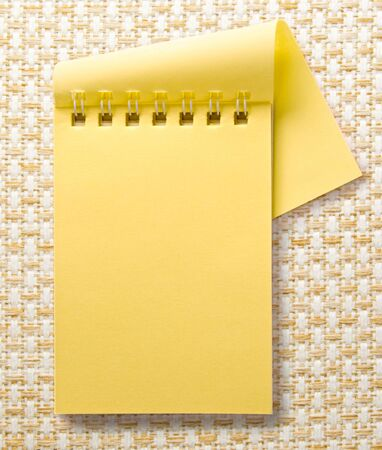 yellow notepad: Open blank yellow notepad with spiral closeup Stock Photo