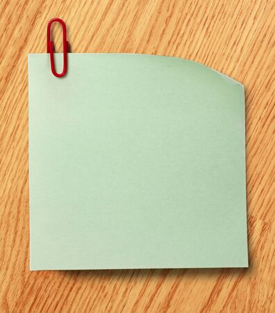Blank green sticker and red clip surface photo