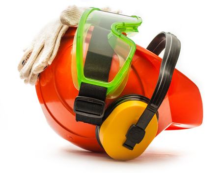 personal safety: Red safety helmet with earphones, goggles and gloves Stock Photo