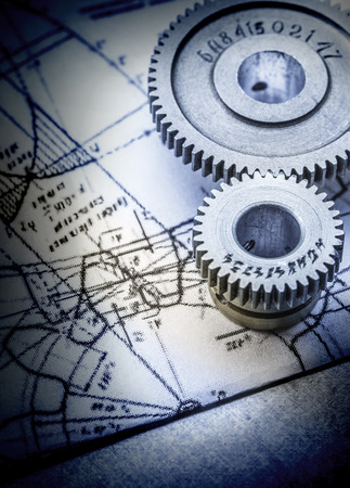 interlink: Steel cogwheels connected on drawing in toning