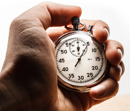 Male hand holding stopwatch on white background Archivio Fotografico