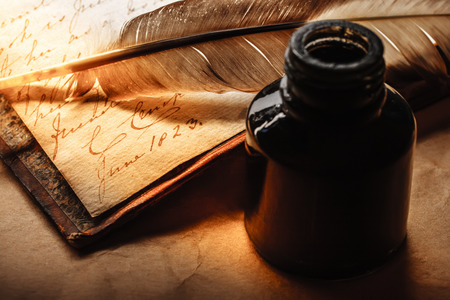 pen and paper: Old book with feather pen and inkpot Stock Photo