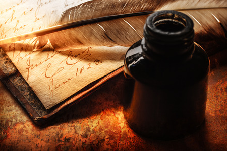inkpot: Old book with feather pen and inkpot Stock Photo
