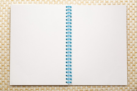 Blank open notepad on the textile background photo