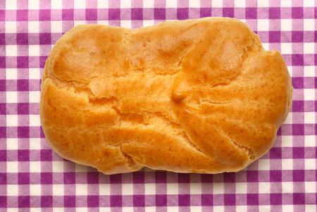 choux bun: Pastry dough eclair with vanilla cream inside