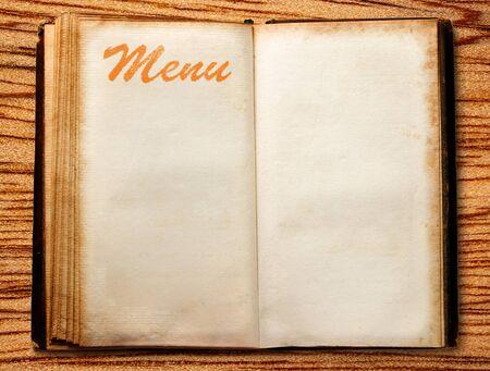One ope blank vintage menu book on wood photo