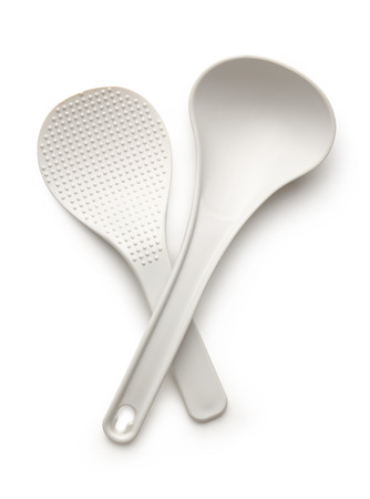 White spatula and ladle isolated on the white background photo