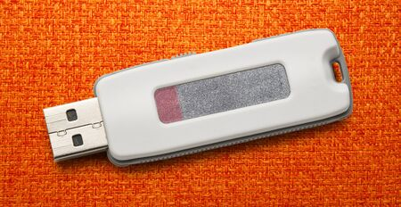 microdrive: Usb flash drive on the cloth background Stock Photo