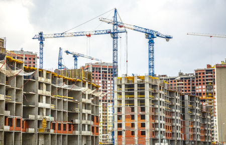 tall buildings: Many tall buildings under construction and cranes Stock Photo