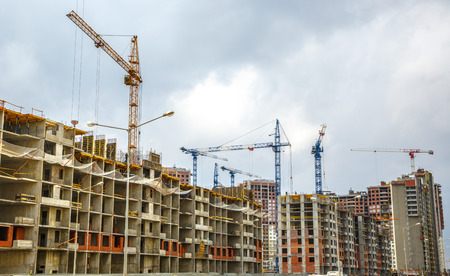 concrete commercial block: Many tall buildings under construction and cranes Stock Photo