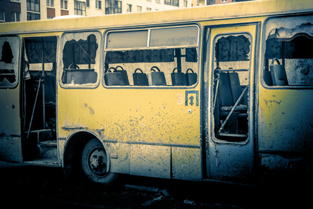 shunt: Old dirty yellow bus with broken windows