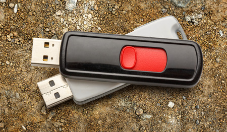 microdrive: Usb flash drives on the ground background