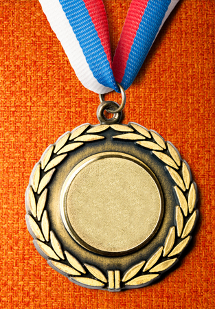 Metal medal with tricolor ribbon in closeup photo