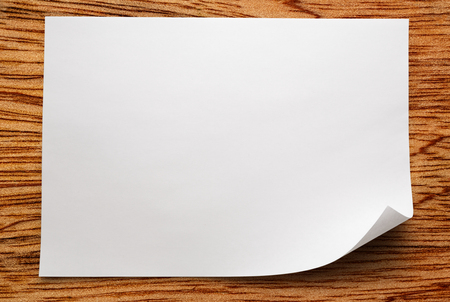 Blank sheet of paper on wooden background photo