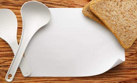 ladles: Blank white sheet of paper with ladles and bread Stock Photo