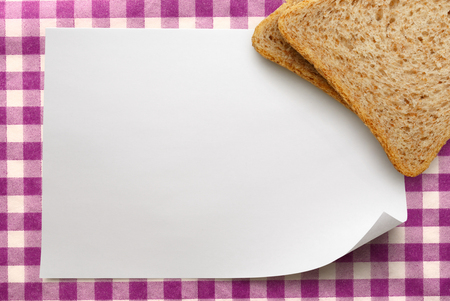 Blank white sheet of paper with bread photo