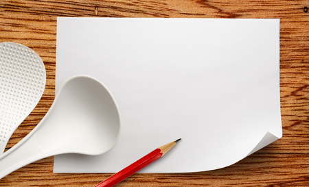 ladles: Blank white sheet of paper with ladles and pencil