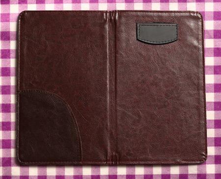 lila: Open blank folder on checked lila background Stock Photo