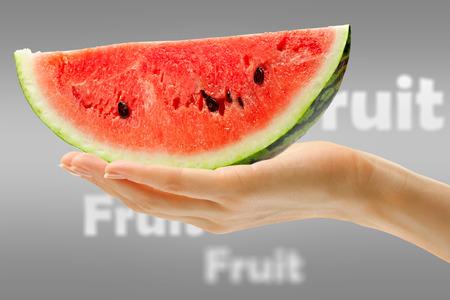 cut wrist: Female hand in closeup holding slice of watermelon Stock Photo