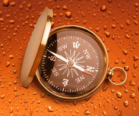 azimuth: Golden vintage compass opened on raindrop background Stock Photo