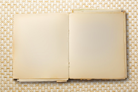 Old blank notebook open on colorful background photo