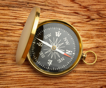 azimuth: Golden vintage compass opened on wooden background Stock Photo