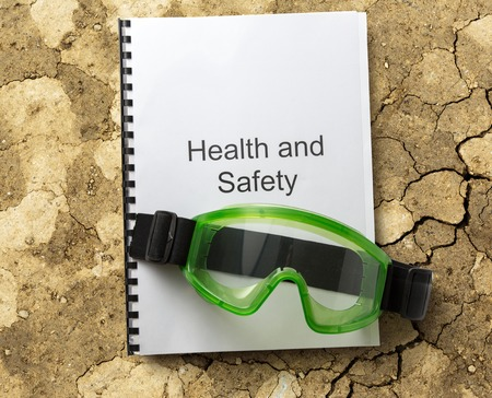 Health and safety register with goggles in closeup